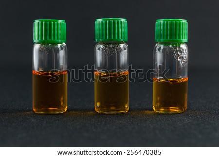 Laboratory medicine reagents used for identification of Mycoplasma and ureaplasma bacteria on black background - stock photo