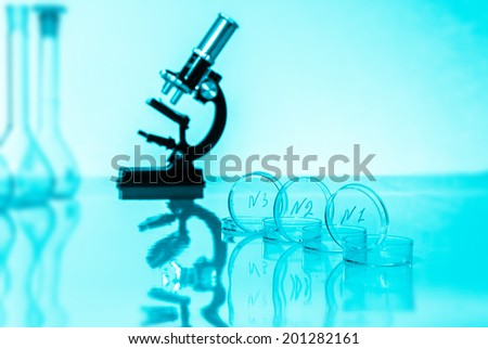 Laboratory microscope lens.modern microscopes in a lab. toned image  - stock photo