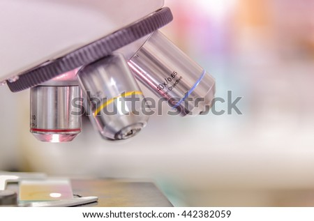 Laboratory Microscope. Scientific research background. - stock photo