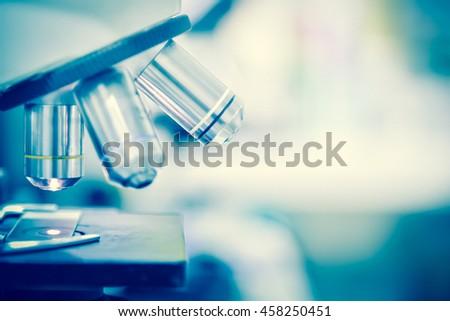 Laboratory Microscope. Scientific research background.white tone. - stock photo