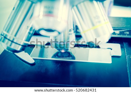 Laboratory Microscope. Scientific research blue background.