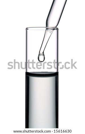 Laboratory pipette with drop of clear liquid inside a glass test tube for an experiment in a science research lab - stock photo