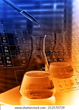 Laboratory research, dropping liquid to flask  - stock photo
