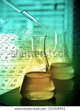 Laboratory research, dropping liquid to test tube  - stock photo