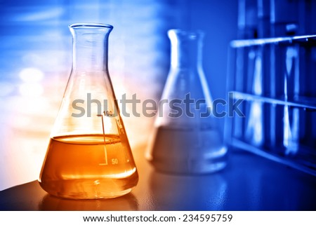 Laboratory research, flask containing chemical liquid  - stock photo