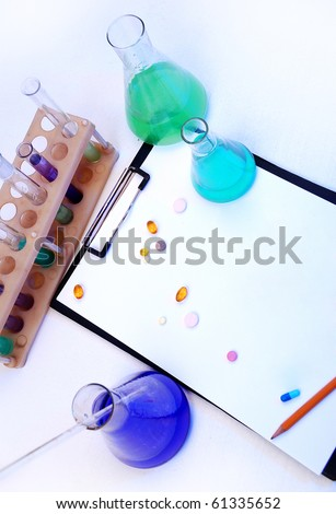 Laboratory research - glass test tubes, tablets and the form - stock photo