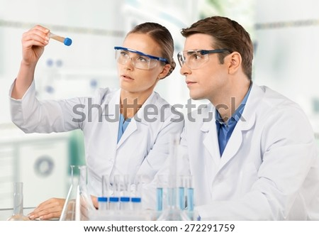 Laboratory. Researcher and doctor looking at a molecular structure - stock photo