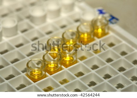 Laboratory researching of influenza, some specimens and equipment - stock photo