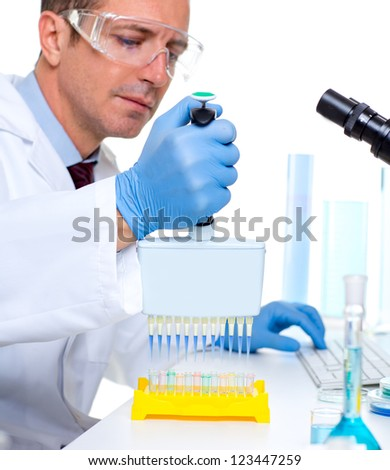 laboratory scientist working at lab with multi channel pipette - stock photo