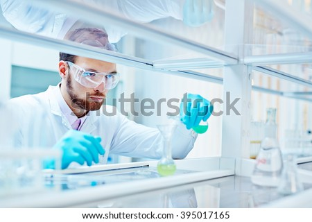 Laboratory scientist working at lab with test tubes - stock photo