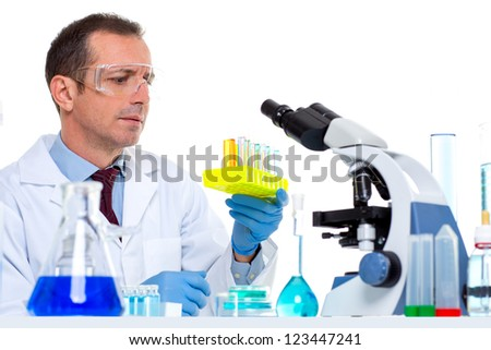 laboratory scientist working at lab with test tubes and microscope - stock photo