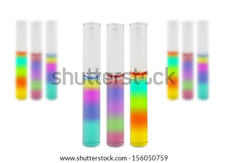 Laboratory Test Tubes Filled with Layered Liquids Isolated on a White Background - stock photo