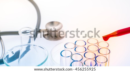 laboratory test tubes,medical glassware , Stethoscope  ( Filtered image processed colorful effect. ) - stock photo