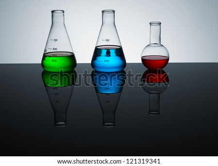 laboratory test tubes with colored liquid, place for text - stock photo