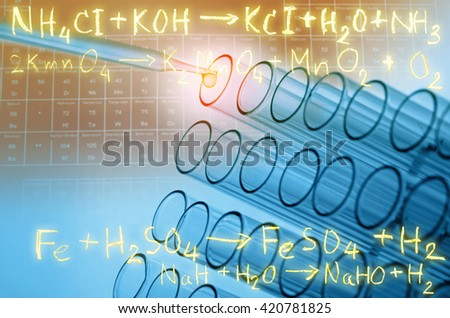 laboratory test tubes with gold chemical equation background - stock photo