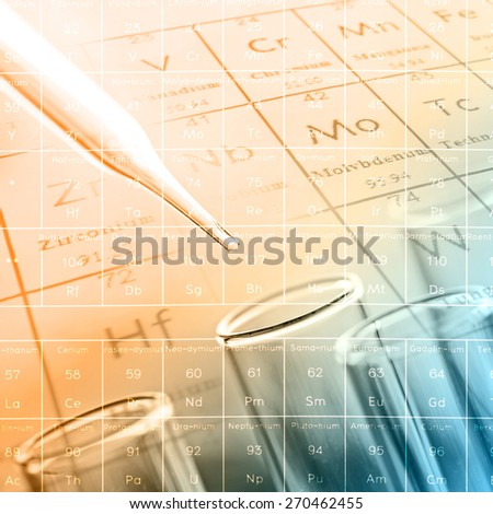 laboratory test tubes with periodic table background - stock photo