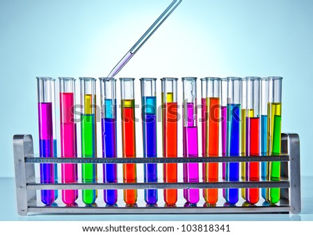 Laboratory test tubes with pipette - stock photo