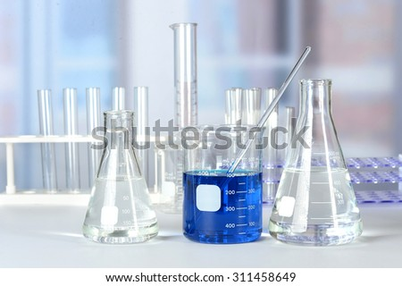 Laboratory with glassware containing liquids