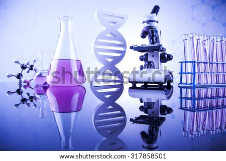 Laboratory work place with microscope and glassware - stock photo