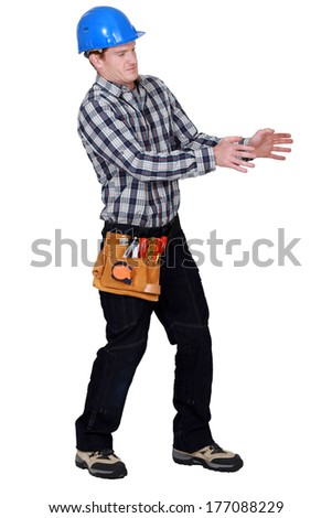 Laborer gesturing on white background - stock photo