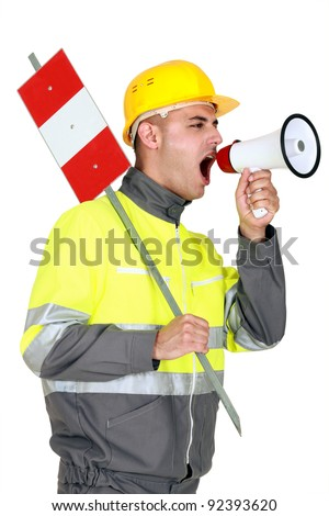 Laborer screaming in a bullhorn - stock photo