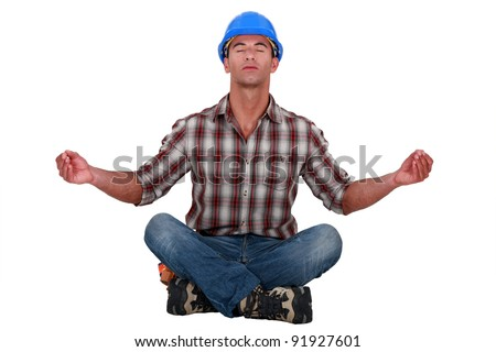 Laborer sitting in a yoga posture - stock photo