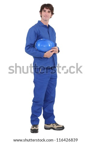Laborer standing on white background