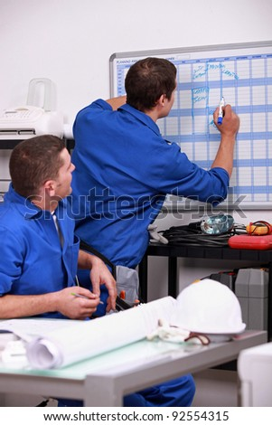 Laborers in office planning appointments - stock photo