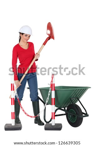 Labourer holding a spade - stock photo