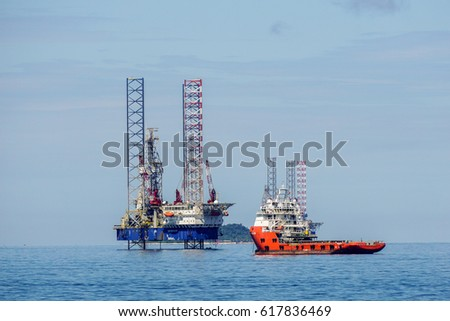 Labuan,Malaysia-Mac 25,2017:Multi function offshore support/platform supply vessels with the lay-up drilling jackup rigs in Labuan Pearl of Borneo,Malaysia on 25th March 2017.