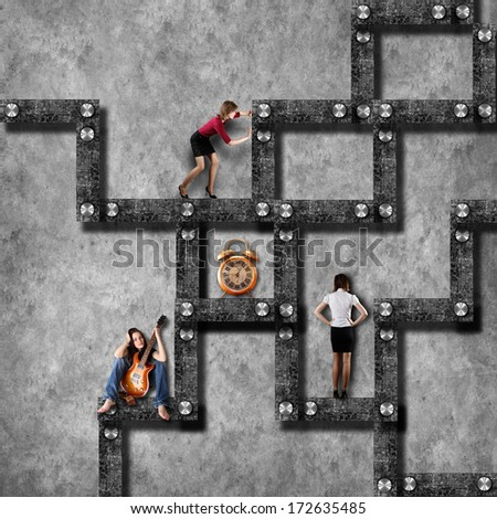 Labyrinth business concept with business woman - stock photo