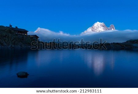 Lac Blanc Hut and Aiguille Verte Peak, Graian Alps, France - stock photo