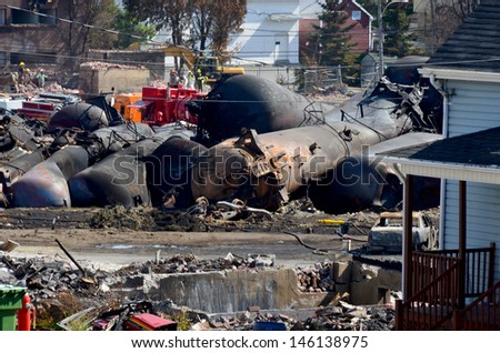 LAC MEGANTIC CANADA JULY 14: Tankers exploded after the wost train disaster in the canadian history on july 14 2013 in Lac Megantic Canada. 50 people was killed in this  humanitarian disaster.