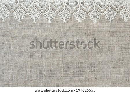 Lace border over burlap - stock photo
