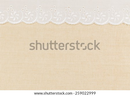 Lace border over Fabric textile texture design for background