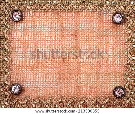 Lace frame on a sacking background - stock photo