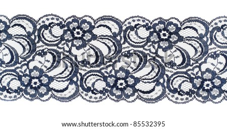 Lace trim ribbon over white. Embroidered fabric. Closeup - stock photo