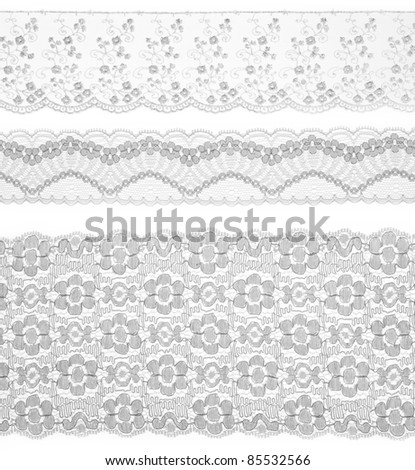Lace trims ribbon over white. Set of embroidered fabric. Closeup - stock photo