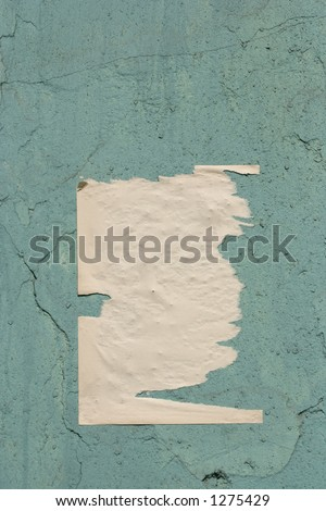lacerated paper on a wall - stock photo