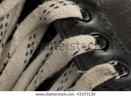 laces details on pair of worn hockey skate - stock photo