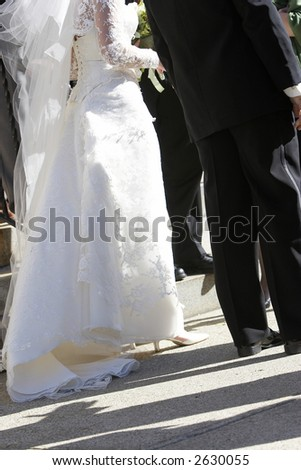 laces on the back of a white wedding dress