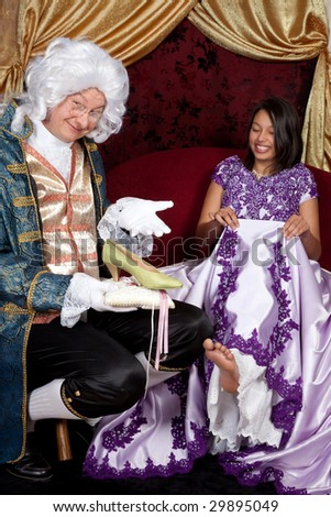 Lackey or prince presenting a golden shoe to cinderella - stock photo
