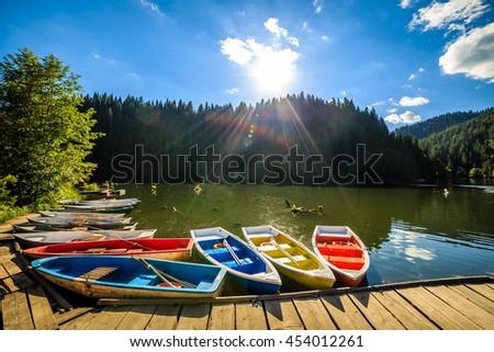 Lacul Rosu the Red Lake or Killer Lake, Eastern Carpathians, Romania - stock photo