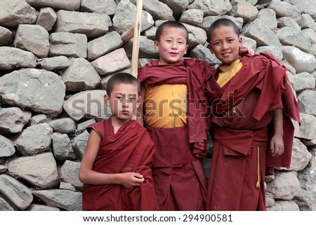 LADAKH, INDIA -AUG 30 :Unidentified Buddhist monks pose for a snap at Hemis monastery on August 30, 2012 in Ladakh, India. Hemis is the biggest tibetan monastery in Ladakh and a tourist attraction. - stock photo