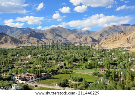LADAKH, INDIA - AUGUST 2, 2014: Ladakh Range is a segment of the Karakoram mountain range, that extends for 370 kilometers. It parallels the northeast bank of the Indus River. - stock photo