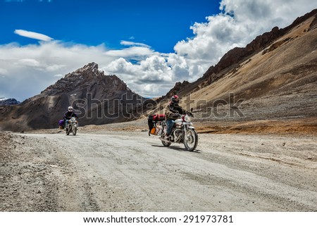 LADAKH, INDIA - SEPTEMBER 2, 2011: Bike tourists in Himalayas on famous high altitude Leh-Manali Highway. Himalayan bike tourism is gaining popularity for tourists and bikers from all over the world - stock photo