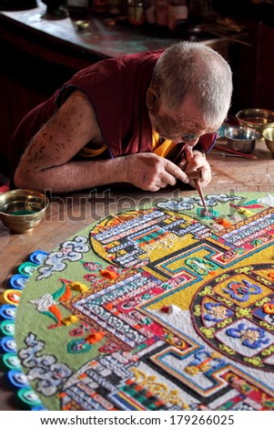 LADAKH, INDIA - SEPTEMBER 03, 2011: Buddhist monks making sand mandala in Diskit gompa at Nubra valley. Mandala - is a spiritual and ritual symbol in Hinduism and Buddhism, representing the Universe - stock photo