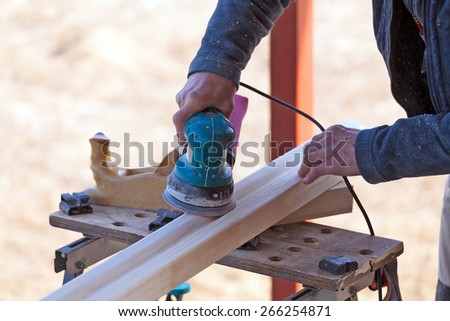 Ladder Carpenter Working Polishing Machine  - stock photo