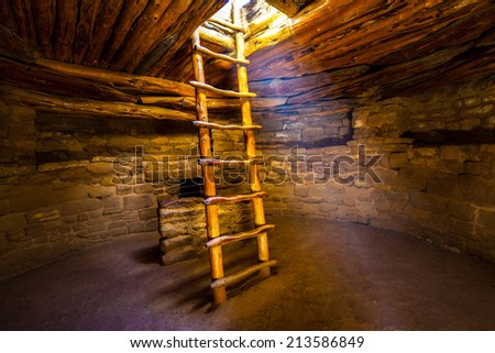 Ladder descending into kiva, Mesa Verde National Park, Colorado. - stock photo