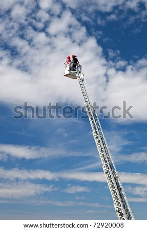Ladder extended on a fire truck. - stock photo